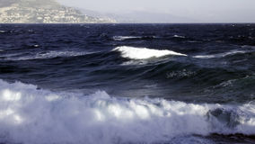 Waves building. Swept up waves in an agitated mediterranean sea Royalty Free Stock Photo