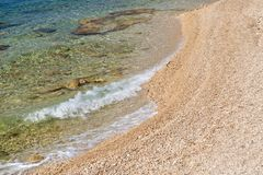 Waves on calm beach with small pebbles royalty free stock photos