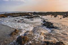 The waves caressing the rocks stock photography