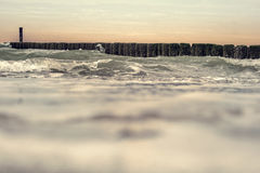 Waves clashing on the breakwater Stock Image