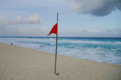 Waves on the coast of the Caribbean Sea, Mexico. Riviera Maya. Stiorm flag on the beac. Waves on the coast of the Caribbean Sea, Mexico. Riviera Maya Stock Photos