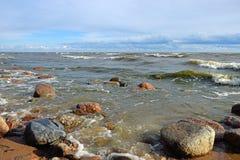 Waves and coastal surf on the sandy beach Stock Image