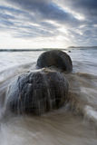 Waves come crashing onto the rocks. Stock Photos