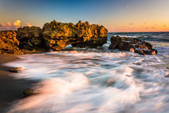 Waves and coral at sunrise in the Atlantic Ocean at Coral Cove P. Ark, on Jupiter Island, Florida Stock Photography