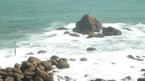 Waves covering rocks on beach in Sri Lanka stock video footage