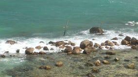 Waves covering rocks on beach in Sri Lanka stock video