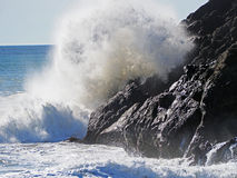 Waves Crash against Rocks Stock Image