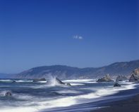 Waves crash against the rocks in Mendocino County California Stock Photography