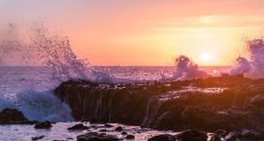 Waves crash against the rocks of tide pools on the California Coast Stock Photo