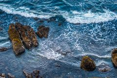 Waves Crash in the Blue Pacific Waters Stock Photography