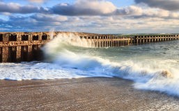 Waves Crash Breakers Hatteras North Carolina. Ocean waves crash against the man-made Groyne at Cape Hatteras National Seashore on the Outer Banks of North Stock Photography