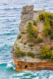 Waves Crash on Miners Castle. Powerful Lake Superior waves crash at the base of Miners Castle, a rock formation in Upper Peninsula Michigan's Pictured Rocks Stock Image