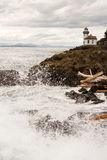 Waves Crash onto Sharp Rocks Jetty San Juan Island Lighthouse royalty free stock image