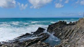 Waves crash rocks background horizon blue sky sea scape stock video