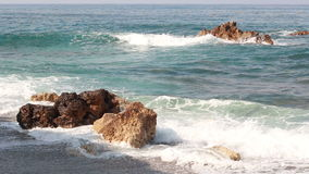 Waves crash on the rocks in the Mediterranean Sea. Waves crash on the two rocks in the Mediterranean Sea stock video footage