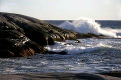 Crashing waves and slippery rocks stock image