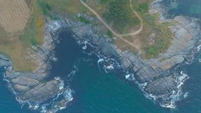 Waves crashes at rocks and nature in Black Sea Bulgaria Aerial top view stock image