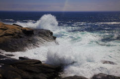 Waves Crashing. The ocean crashes hard against the rocks Stock Images