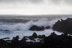 Waves crashing against black volcanic rock formations. Ponta da ferraria in São Miguel island, Azores stock image