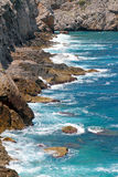 Waves crashing against cliff in mallorca Stock Photos