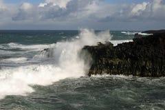 Waves crashing against cliffs Stock Image