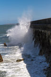 Waves crashing against Holyhead Breakwater. Stock Photography