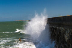 Waves crashing against Holyhead Breakwater. Royalty Free Stock Image
