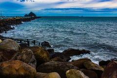 Taranaki Coast, New Plymouth, NZ. Waves crashing against rocks along the Taranaki Coast, New Plymouth, New Zealand, Aotearoa Royalty Free Stock Image