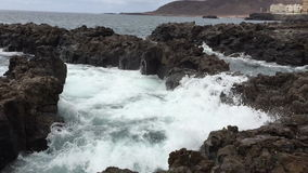 Waves crashing against the rocks stock footage