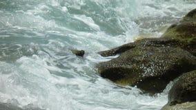 Waves crashing. Against rocks in Jupiter Florida stock photography