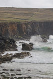 Waves crashing against rocks and sea cliffs, Dingle Peninsula Stock Photography