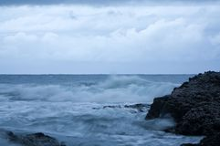 Waves crashing against rocks on a stormy day in Umhlanga South Africa. Powerful and magestic waves Stock Photography