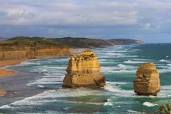 Waves crashing against rocky outcrops at the Twelve Apostles stock image
