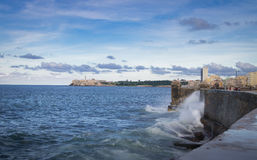 Waves crashing against the wall of El Malecon - Havana, Cuba. Waves crashing against the wall of El Malecon in Havana, Cuba Royalty Free Stock Image