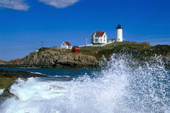 Waves Crashing Around Nubble Lighthouse in Maine Stock Photo