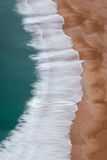 Waves Crashing on Beach Aerial View Vertical Image Stock Photography