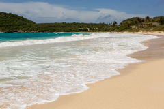 Waves Crashing on Beach at Half Moon Bay Antigua Stock Images
