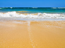 Waves crashing on a beach Stock Photography