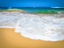 Waves crashing on a beach Royalty Free Stock Photo