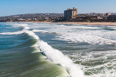 Waves Crashing on Beach at Pacific Beach in San Diego Stock Photo