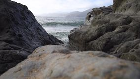 Waves crashing on the beach. Waves crashing on the rocky beach with overcast skies. California coastline USA stock video