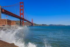 Waves crashing by the iconic Golden Gate Bridge in San Francisco. Waves crashing beneath the iconic Golden Gate Bridge in San Francisco, CA stock photography