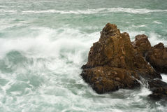 Waves crashing into big rocks Royalty Free Stock Photo