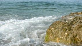 Waves crashing on big stone Stock Image