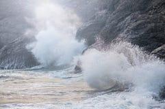 Waves crashing on the rocks royalty free stock photo