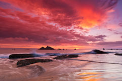 Waves Crashing with Bright Colorful Sky stock images