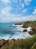 Waves crashing coastal rocks Royalty Free Stock Images