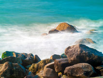 Waves Crashing. Waves crash over rocks at Milford on Sea, near Lymington in the New Forest National Park Stock Photography