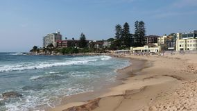 Waves Crashing on Cronulla Beach, Sydney, Australia. White capped Pacific Ocean waves, surf and foam wash over yellow sand at Cronulla Beach, Sutherland Shire stock footage