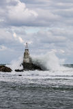 Waves crashing into lighthouse Royalty Free Stock Image